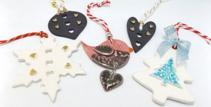 a selection of porcelain Christmas decorations