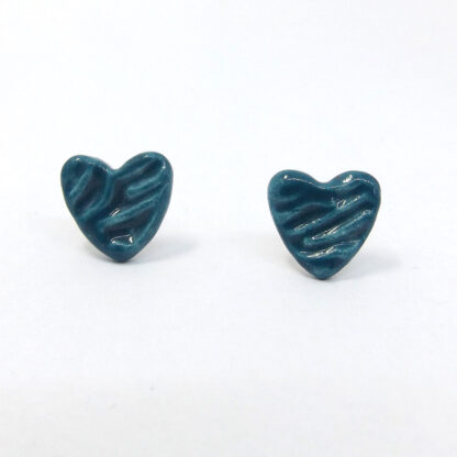 These heart stud earrings have been handmade from earthenware clay, imprinted with a geometric design and glazed in teal Blue
